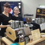 Our friendly baristas serving coffee in an office breakroom