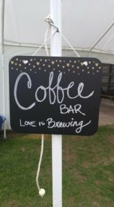 The sign pointing guests to our coffee cart
